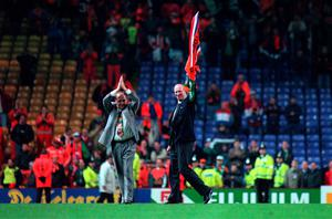 Jack Charlton waves to the crowd, with his assistant Maurice Setters, after Ireland were defeated by Holland in what was Charlton's last game as manager. European Championship Qualifying Play-Off, Holland v Rep of Ireland, Anfield. Picture Credit: David Maher/SPORTSFILE.