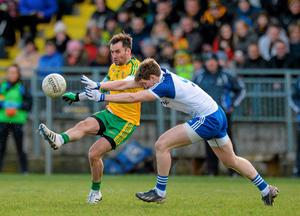Monaghan's Darren Hughes keeps the pressure on Donegal's Karl Lacey during their game in Letterkenny