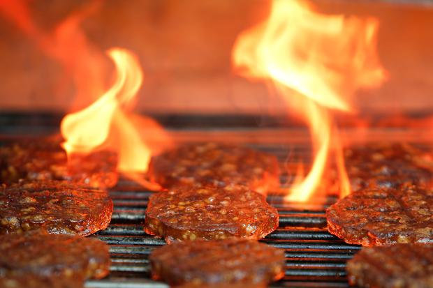 Veggie burgers are cooked over a flame on a grill in Greenwich, Connecticut, U.S., on June 26, 2017. REUTERS/Adrees Latif