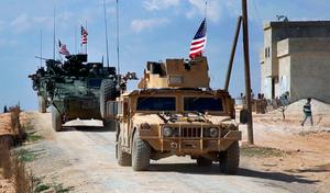 US forces patrol the edge of Manbij, Syria, a flashpoint between Turkish troops and allied Syrian fighters and US-backed Kurds. Photo: AP