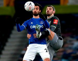 Everton's Andre Gomes and Sheffield Wednesday's Callum Paterson battle for the ball. Photo: PA