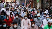 People wearing protective face masks in Manama, Bahrain. Photo: REUTERS/Hamad I Mohammed