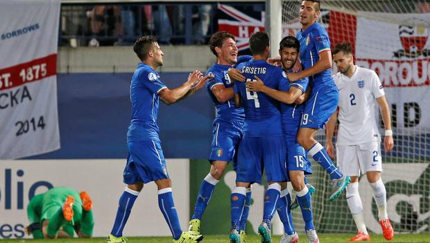 Marco Benassi celebrates with team mates after scoring the third goal for Italy