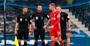 Liverpool's Jordan Henderson speaks to referee Michael Oliver after the match