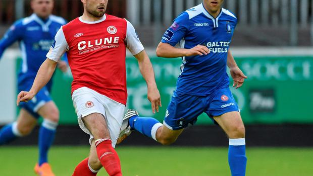 St Pat's Christy Fagan in action against Shane Tracy of Limerick