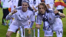 Real's Gareth Bale, left, and Luka Modric celebrate with the trophy at the end of the final of the Copa del Rey between FC Barcelona and Real Madrid