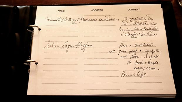 Messages written by President Michael D Higgins and his wife Sabina in a book of condolence opened at Mansion House in Dublin for those killed in the Berkeley balcony collapse. Niall Carson/PA Wire