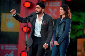 Actors Arjun Kapoor (L) and Freida Pinto speak on stage at the 2015 Global Citizen Festival to end extreme poverty by 2030 in Central Park on September 26, 2015 in New York City.  (Photo by Theo Wargo/Getty Images for Global Citizen)