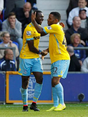 Crystal Palace's Yannick Bolasie (left) celebrates scoring his sides second goal of the game with team-mate Crystal Palace's Jason Puncheon during the Barclays Premier League match at Goodison Park, Liverpool. PRESS ASSOCIATION Photo. Picture date: Sunday September 21, 2014. See PA story SOCCER Everton. Photo credit should read: Peter Byrne/PA Wire. RESTRICTIONS: Editorial use only. Maximum 45 images during a match. No video emulation or promotion as 'live'. No use in games, competitions, merchandise, betting or single club/player services. No use with unofficial audio, video, data, fixtures or club/league