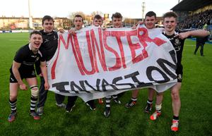 Cistercian College Roscrea players celebrate their victory over Newbridge with their 'Munster Invasion' flag