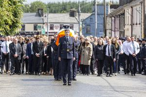 Gardaí carry the coffin of their slain colleague, Detective Garda Colm Horkan to St James' Church, Charlestown for his funeral Mass on Sunday. Pics: Donal Hackett and Carl Brennan