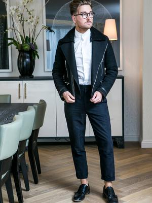 Rob Kenny wears Shirt, Paul Galvin at Dunnes Stores; coat, Sandro Paris; trousers, H&M Studio Collection; shoes, Hudson London; glasses, Specsavers. Picture: Kyran O'Brien