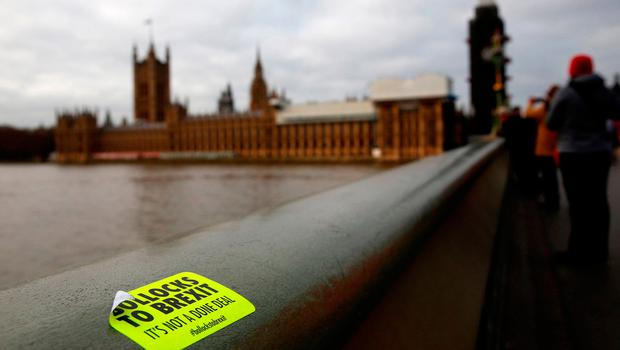 An anti-Brexit sticker is pictured on Westminster Bridge in central London. Photo: AFP/Getty Images