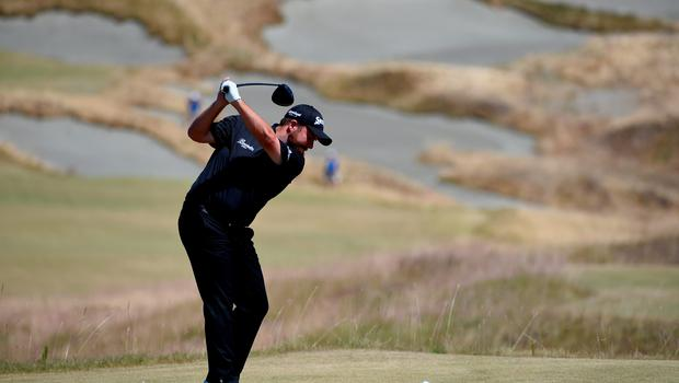 Shane Lowry of Ireland hits his tee shot on the fourth hole during the final round of the 115th U.S. Open Championship at Chambers Bay