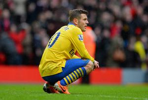 Jack Wilshere of Arsenal looks dejected at the end of the Barclays Premier League match between Liverpool and Arsenal