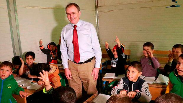 Minister of State Joe McHugh meeting Syrian children at a camp school. Photo: PA