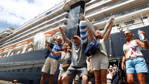 Passengers react after they disembark from the MS Westerdam. AP Photo/Heng Sinith
