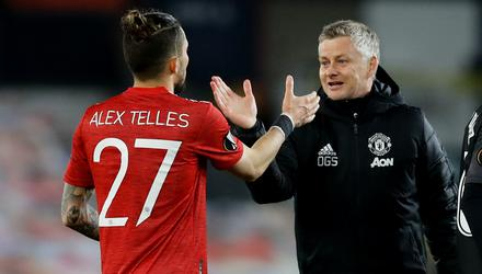 Manchester United manager Ole Gunnar Solskjaer congratulates Alex Telles after the Europa League quarter-final second leg win over Granada