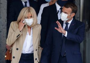 Behind the mask: French President Emmanuel Macron and his wife Brigitte leave after casting their ballots. Photo: Reuters/Pascal Rossignol