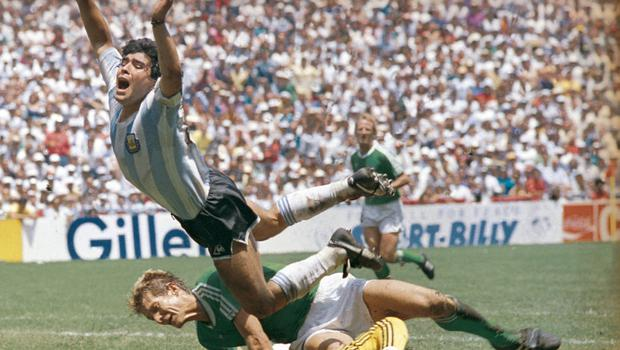 Diego Maradona fights for the ball with West Germany goalkeeper Harald Schumacher during the 1986 World Cup final at the Azteca Stadium in Mexico City