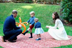 Catherine, Duchess of Cambridge, Princess Charlotte of Cambridge and Prince George of Cambridge, Prince William, Duke of Cambridge at a children's party for Military families during the Royal Tour of Canada