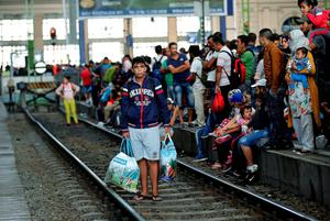 Migrants wait for trains at the railway station in Budapest, Hungary, Thursday, Sept. 3, 2015. Over 150,000 migrants have reached Hungary this year, most coming through the southern border with Serbia, and many apply for asylum but quickly try to leave for richer EU countries.(AP Photo/Frank Augstein)