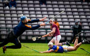 Shooting star: Galway's Conor Whelan shoots to score his side's second goal despite the efforts of Padraic Maher (right) and goalkeeper Brian Hogan during the Allianz NHL clash at Pearse Stadium. Photo: Sam Barnes/Sportsfile