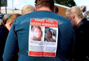 A poster on the back of a volunteer as people from the local community gather near to the home of missing teenager Amber Peat in Mansfield as police organise people into small groups to search the local area. Chris Radburn/PA Wire