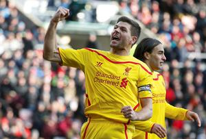 Liverpool's Steven Gerrard celebrates the goal of teammate Lazar Markovic during their 1-0 win at Sunderland