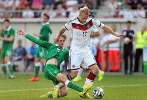 Goal scorer Philipp Hofmann is challenged by Ireland's Mason Watkins during the Under 21 Qualifier between Germany U21 and The Republic of Ireland U21 at Erdgas Sportpark in Halle, Germany. Photo credit: Ronny Hartmann/Bongarts/Getty Images