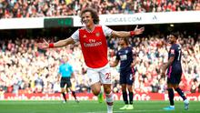Arsenal's David Luiz celebrates scoring his sides first goal of the game during the Premier League match at the Emirates Stadium, London. PA Photo. Picture date: Sunday October 6, 2019. See PA story SOCCER Arsenal. Photo credit should read: Tim Goode/PA Wire.