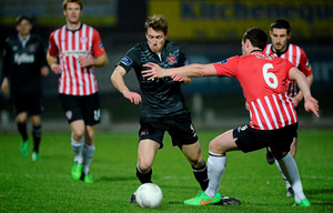 David McMillan, Dundalk, in action against Shane McEleney, Derry City.