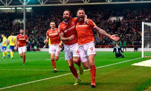 Nottingham Forest's Daryl Murphy (right) celebrates scoring his side's third goal of the game during the Sky Bet Championship match at the City Ground, Nottingham. Joe Giddens/PA Wire