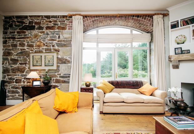 Susan Gorman and Alan Ross: the sitting room features the station's original stonework. Photo credit: RTE