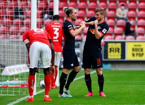 HUNGRY FOR GOALS: Leipzig's Timo Werner (r) celebrates scoring their fourth side's goal with Kevin Kampl (c) during the Bundesliga match against Mainz 05 in Mainz yesterday. Photo: Getty Images