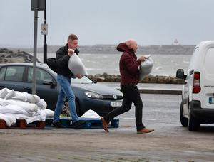 Local mem collect sandbags at Salthill in Galway as storm Lorenzo tracked up the west coast of Ireland.Picture Credit:Frank McGrath
