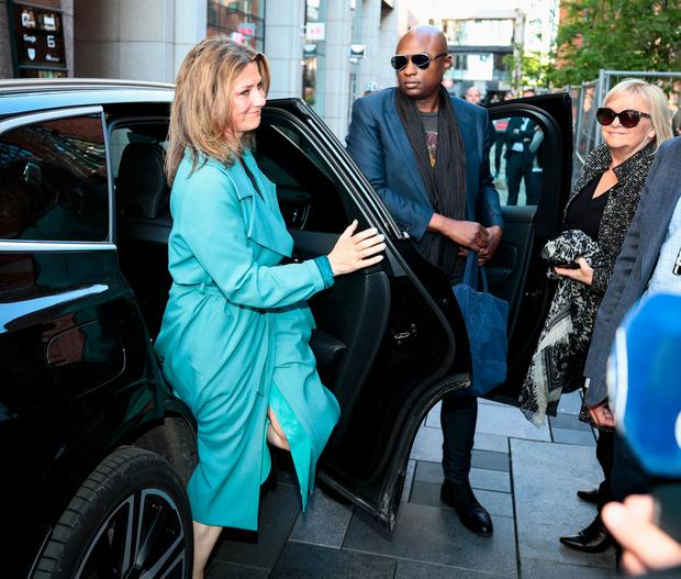 """Norwegian princess Martha Louise and her boyfriend US shaman Durek Verrett arrive on May 16, 2019 to take part in the morning show """"God Morgen Norge"""" at the TV2 studio in Oslo, Norway. (Photo by Lise vÖserud / NTB Scanpix / AFP)"""