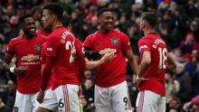 Manchester United's Anthony Martial celebrates scoring their second goal with Bruno Fernandes and teammates