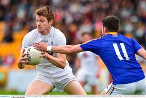 Kildare's Kevin Feely of Kildare in action against Barry McKeon of Longford. Photo: Matt Browne/Sportsfile