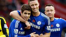 Chelsea's Gary Cahill and Oscar celebrate after their victory over Liverpool