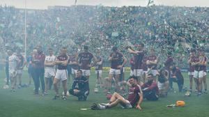 Galway's dejected hurlers are pictured through the smoke from the celebration fireworks after their 2018 All-Ireland final loss to Limerick. Photo: Brendan Moran/Sportsfile