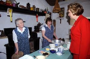 It's the real thing....President Mary McAleese gets a fresh loaf of bread from Mary Cahill and Anne Cronin during her 2009 visit to Muckross Traditional Farms in Killarney. Photo by Michelle Cooper Galvin