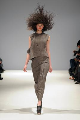Wild and wonderful: Model wearing woven birch twig hat at Joanne Hynes AW2011 fashion show
