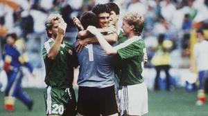 David O'Leary is congratulated by team-mates after Ireland's famous win over Romania at the 1990 World Cup. Photo by Ray McManus/Sportsfile