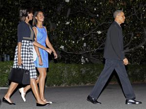 President Barack Obama, first lady Michelle Obama, and daughter Malia walk to Marine One on the South Lawn of the White House in Washington, Sunday, June 16, 2013.