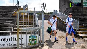 Skryne players Robbie Clarke, left, and Tommy Carpenter arrive to the pitch in their kit, carrying their gear bags, ahead of the Meath SFC match against Simonstown Gaels at Páirc Tailteann in Navan, Meath last Sunday. Photo: Ramsey Cardy/Sportsfile