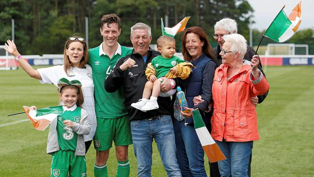 Ireland captain and match-winner Luke Evans with his family at St George's Park after their victory over Argentina