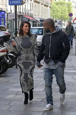 Kim Kardashian and Kanye West are seen strolling on the 'Rue Pierre Charron' on April 14, 2014 in Paris, France.  (Photo by Marc Piasecki/GC Images)