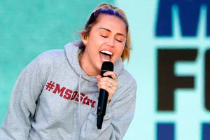 """Miley Cyrus performs """"The Climb"""" during the March for Our Lives rally on March 24, 2018 in Washington, DC"""