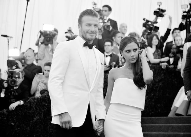 """David Beckham and Victoria Beckham attend the """"Charles James: Beyond Fashion"""" Costume Institute Gala at the Metropolitan Museum of Art on May 5, 2014 in New York City.  (Photo by Andrew H. Walker/Getty Images)"""